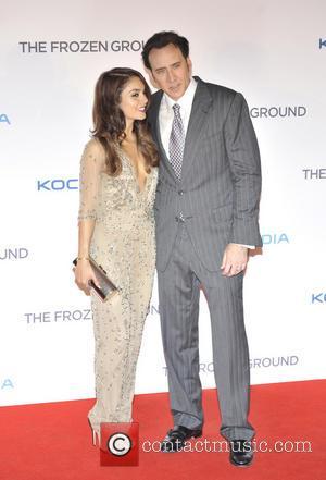 Vanessa Hudgens and Nicholas Cage