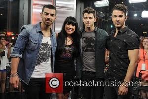 Joe Jonas, Lauren Toyota, Nick Jonas and Kevin Jonas