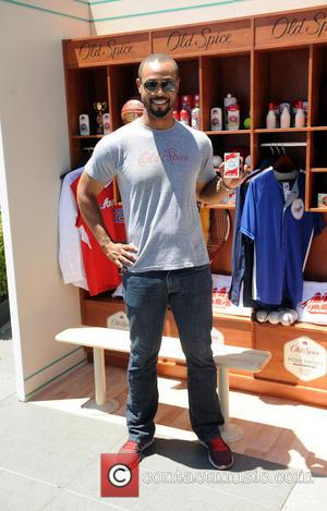 Isaiah Mustafa - Isaiah Mustafa makes a guest appearance at The Old Spice interactive shower at L.A. Live during the...
