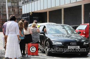 Kym Marsh and Kym Lomas - Kym Marsh stops and talks to waiting fans as she leaves the Coronation Street...