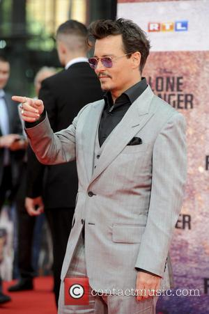 Johnny Depp - The German premiere of 'The Lone Ranger' at Cinestar Movie Theater - Arrivals - Berlin, Germany -...