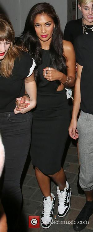 Nicole Scherzinger and Miley Cyrus