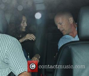 Bruce Willis and Emma Heming - Bruce Willis and wife Emma Heming arrive at C London for dinner - London,...