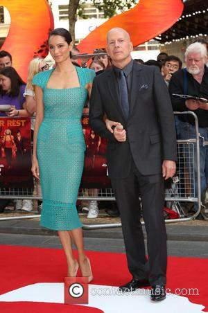 Bruce Willis, wife and Emma Herring - Red 2 UK film premiere held at the Empire Cinema in Leicester Square...