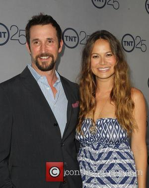 Noah Wyle and Moon Bloodgood