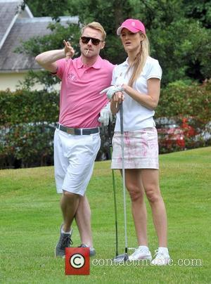 Ronan Keating and Storm Uechtritz - Singer Ronan Keating was all hands as he gave his girlfriend Storm Uechtritz a...