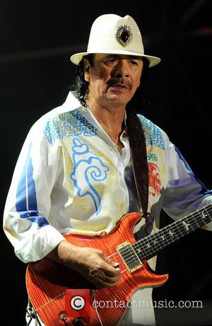 Carlos Santana - Carlos Santana performs at the City Sound festival 2013 at Ippodromo Del Galoppo - Milan, Italy -...