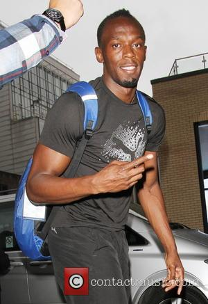 Usain Bolt - Olympic Athletes arrive and exit their hotel for the Anniversary Games 2013 - London, United Kingdom -...