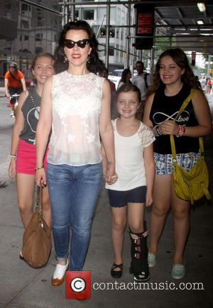 Debi Mazar, Giulia Isabel Corcos and Evelina Maria Corcos - Special screening of 'The Smurfs 2' held at Lighthouse International...