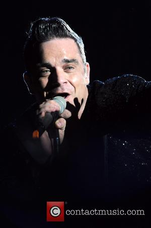 Robbie Williams - Robbie Williams performs in concert at the San Siro stadium - Milan, Italy - Wednesday 31st July...