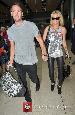 Sarah Harding and Mark Foster - Girls Aloud member Sarah harding arriving at Dublin Airport with her boyfriend mark Foster....