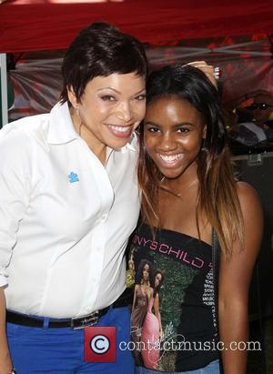 Tisha Campbell and Guest