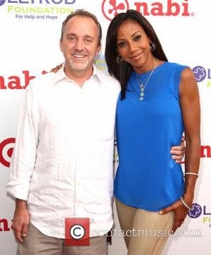 Jim Mitchell and Holly Robinson Peete