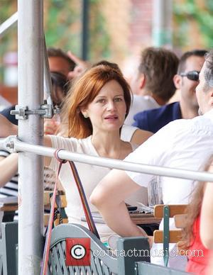 Carla Gugino - Carla Gugino sitting at an outdoor cafe table with her dog - New York City, NY, United...