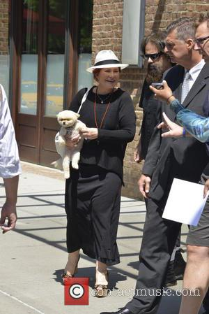 Sharon Osbourne and Mr. Chips - Sharon Osbourne leaving her hotel carrying her pomeranian dog, Mr Chips - New York,...