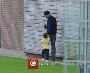 Luis Suarez and Delphina Suarez - Luis Suarez was seen heading for the exit today at Liverpool football clubs training...