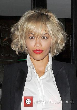 Rita Ora - Rita Ora arrives at Percy & Reed hair salon in Marylebone with sister Elena Ora, shortly after...