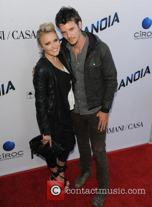 Emily Osment and Nathan Keyes - Red Carpet Arrivals for the US premiere of PARANOIA - LA, CA, United States...