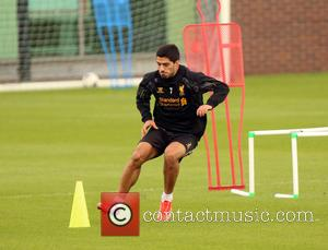 Luis Suarez - Troubled Liverpool FC player Luis Suarez takes part in a one-on-one training session with coaching staff member...