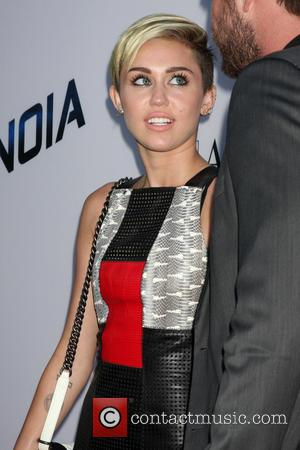 Miley Cyrus And Liam Hemsworth Put On United Front At Film Premiere