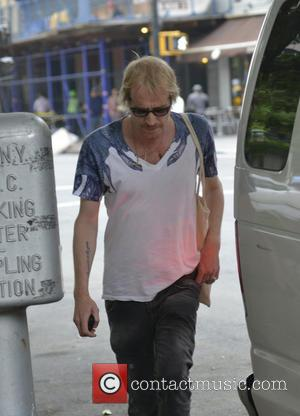 Rhys Ifans - Rhys Ifans on his way to a movie set - Manhattan, NY, United States - Saturday 10th...