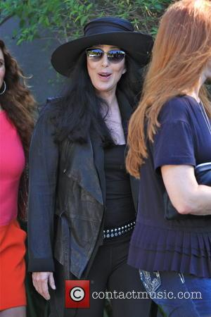 cher - cher was all smile while coming out of a friend house in brentwood - Brentwood, CA, United States...