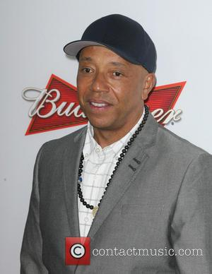 Russell Simmons - Lee Daniels' The Butler Premiere held at the L.A.Live Regal Cinemas - Los Angeles, CA, United States...