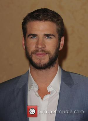 Liam Hemsworth Considers One Of Bon Iver's Songs A Curse