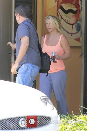 Britney Spears - britney spears is working hard to keep her self on shape, she was pictured coming out of...