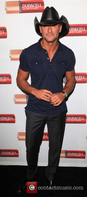 Tim McGraw - Tim McGraw helps to launch Duracell's 'Quantum Heroes Video Series' with FDNY Firehouse Engine 33 in Manhattan...