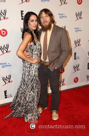 Hope, Brie Bella and Daniel Bryan
