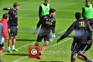 Luis Suarez - Luis Suarez is seen training with the first team at melwood for the first time since his...