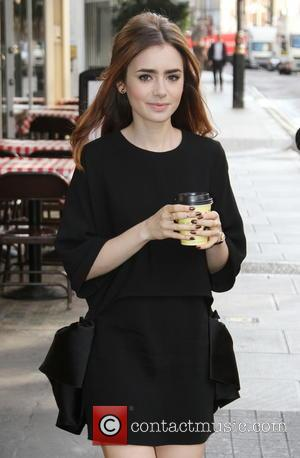 Lily Collins - Lily Collins grabs a takeaway coffee in Soho - London, United Kingdom - Monday 19th August 2013
