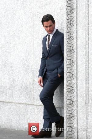 Matt Bomer - Matt Bomer looking sharp in a grey suit filming a scene for TV series 'White Collar' -...