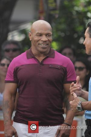 Mike Tyson - Celebrities make an appearance on Extra TV Show - Los Angeles, CA, United States - Tuesday 20th...