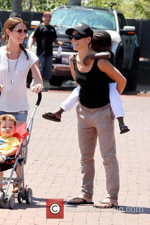 Jillian Michaels - Jillian Michaels takes her daughter Lukensia by piggyback to the park in Malibu - Los Angeles, CA,...