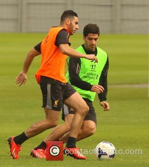Luis Suarez and Oussama Assaidi - Luis Suarez looked to have had a bad day in training, first getting hit...