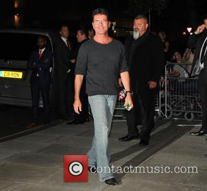Simon Cowell Kisses Lauren Silverman On Holiday