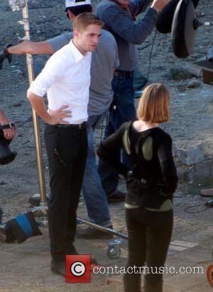 Robert Pattinson - Robert Pattinson and Mia Warsikowska on the set of their new film 'Maps to the Stars' -...