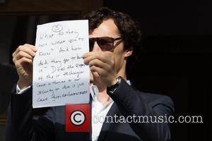 Benedict Cumberbatch - Benedict Cumberbatch holds up a sign in protest of the recent detention of a journalist. - London,...