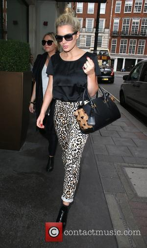 helen flanagan - helen flanagan returning to her hotel after a shopping trip in London - London, United Kingdom -...