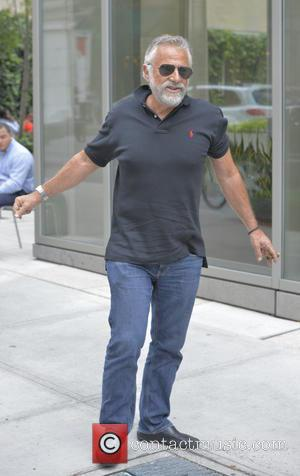 Jonathan Goldsmith - 'The Most Interesting Man in the World' Jonathan Goldsmith smokes a cigar while out and about with...