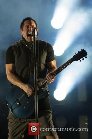 Rockers Nine Inch Nails Send Fans Mysterious Package With Black Powder And Note