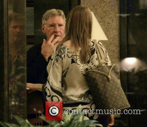 Harrison Ford - Harrison Ford leaves his hotel to a large group of press and fans before being driven to...