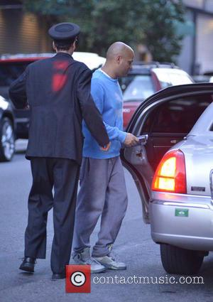 Mel B and Stephen Belafonte - A covered up Mel B, carrying a pillow, checks out of her Manhattan hotel...