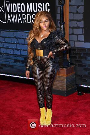 What Do You Buy The Rapper Who Has Everything? Lil' Kim Shares Baby Gift List With Fans