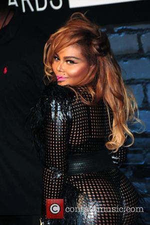 Lil' Kim - The 2013 MTV Video Music Awards - Arrivals at the Barclays Center - NY, NY, United States...