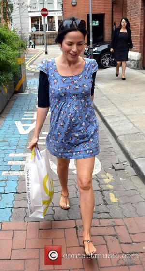 Andrea Corr - Pregnant pop singer Andrea Corr spotted wearing a short blue maternity dress and carrying a Benetton shopping...