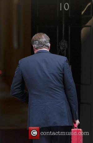 Prime Minister David Cameron - Prime Minister David Cameron arrives at 10 Downing Street after cutting his holiday short, to...
