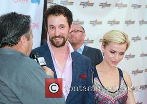 Noah Wyle and Sara Wells
